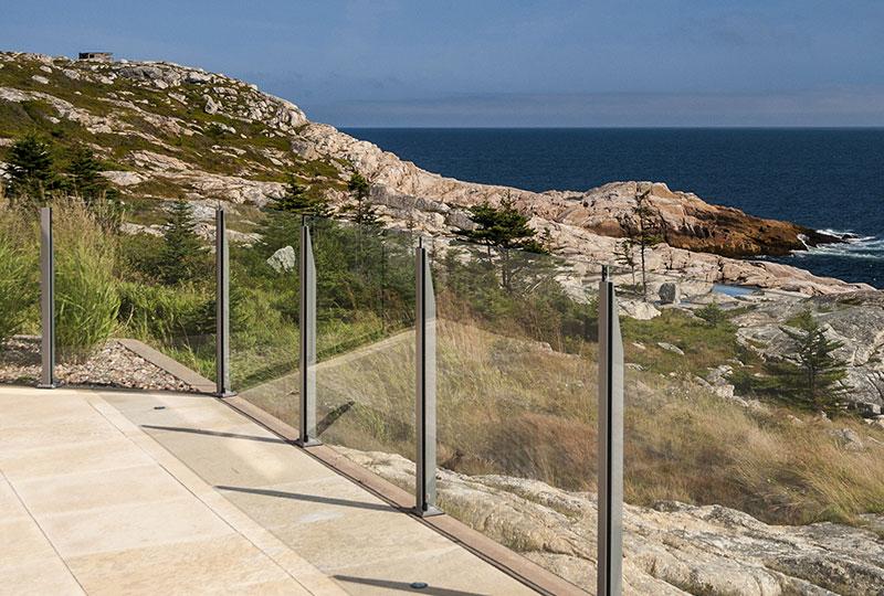 Infinity Topless Railing- Glass Railings- Innovative Aluminum Systems- Aldergrove BC- frameless glass- aluminum railings- house-glass railings outdoors-ocean front